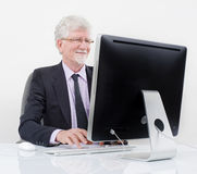 Senior businessman with computer. Over white Royalty Free Stock Image