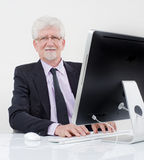 Senior businessman with computer. Over white Stock Photography