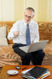 Senior Businessman with Computer Drinking Coffee Stock Photography