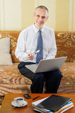Senior Businessman at Computer Stock Photo
