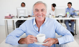 Senior businessman drinking a coffee Royalty Free Stock Images