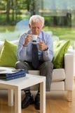 Senior businessman drinking coffee Stock Image