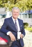 Senior businessman drinking coffee Royalty Free Stock Images