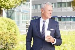 Senior businessman drinking coffee Royalty Free Stock Photo
