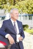 Senior businessman drinking coffee Royalty Free Stock Photos