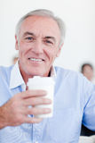 Senior businessman drinking a tea Stock Photography