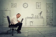 Senior businessman executive working on laptop in office Royalty Free Stock Photography