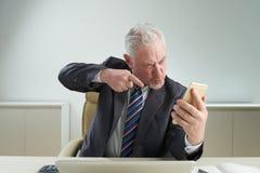 Senior Businessman Expressing Negative Emotions Royalty Free Stock Photo
