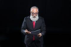 Senior businessman in eyeglasses Stock Photo