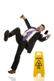 Senior Businessman Falling on Wet Floor