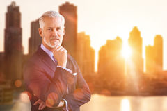 Senior businessman in front of the big city Royalty Free Stock Photos