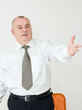 Senior businessman gesturing Stock Photo