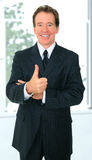 Senior Businessman Give Ok Sign With Hand Gesture. Successful senior caucasian business male give an ok sign with his hand Royalty Free Stock Photography