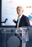 Senior businessman giving a speech Royalty Free Stock Photo