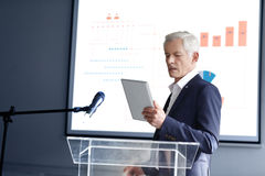 Senior businessman giving a speech Royalty Free Stock Images