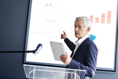 Senior businessman giving a speech Royalty Free Stock Photography