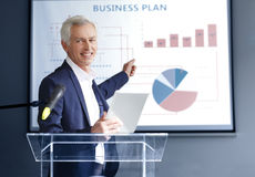 Senior businessman giving a speech Stock Image