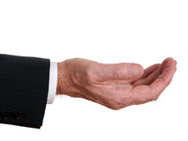 Senior businessman hand outstretched - asking or offering. Royalty Free Stock Images