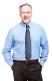 Senior businessman with hands in his pockets Royalty Free Stock Image