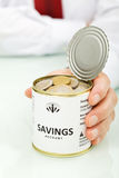 Senior businessman hands holding can with coins Stock Photo