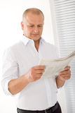 Senior businessman happy read newspapers portrait Stock Images
