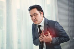 Senior Businessman has heart attack. Exhausted, Illness, disease Royalty Free Stock Image