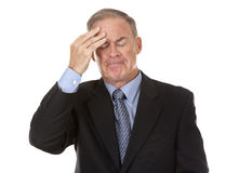 Senior businessman having headache Stock Photography