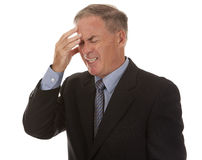 Senior businessman having headache Stock Image