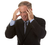 Senior businessman having headache Stock Images