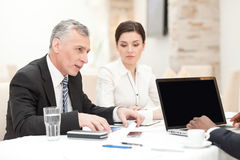 Senior businessman having staff meeting Stock Images