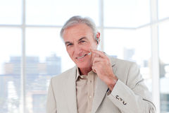 Senior businessman with headset on Royalty Free Stock Photos