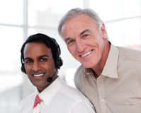 Senior businessman helping his colleague Royalty Free Stock Photography