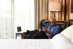 Senior Businessman in his hotel room royalty free stock image