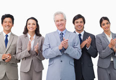 Senior businessman and his team applauding. Against a white background stock photos