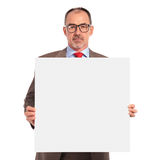 Senior businessman holding a blank board Royalty Free Stock Images