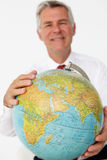Senior businessman holding globe Stock Photo