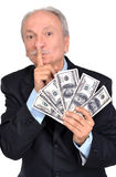 Senior businessman holding group of dollars Royalty Free Stock Images