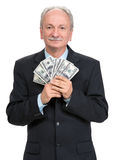 Senior businessman holding group of dollars Royalty Free Stock Image