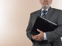 Senior Businessman Holding Leather Binder Royalty Free Stock Images