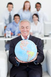 Senior businessman holding a terrestrial globe Royalty Free Stock Image