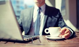 Senior businessman with laptop and coffee outdoors royalty free stock photos