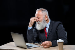 Senior  businessman with laptop Royalty Free Stock Photo
