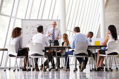 Senior Businessman Leading Meeting At Boardroom Table royalty free stock photography