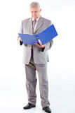 Senior Businessman Looking At Documents Stock Photo