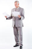 Senior Businessman Looking At Documents Stock Image