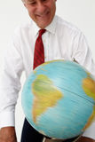 Senior businessman looking and spinning a globe Royalty Free Stock Images