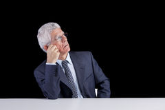 Senior businessman looking up Royalty Free Stock Image