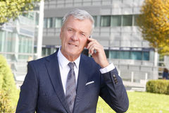 Senior businessman making call Royalty Free Stock Photo