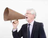 Senior businessman megaphone. Senior businessman using a retro megaphone Stock Photos