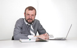 Senior businessman in the office Stock Photos